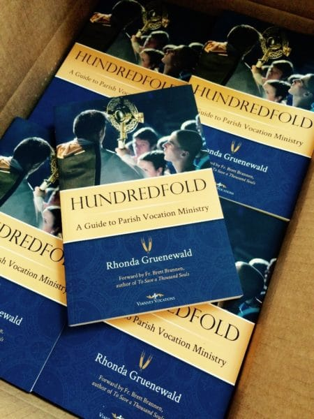 copies of Hundredfold book.