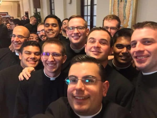 Group of priests taking a selfie