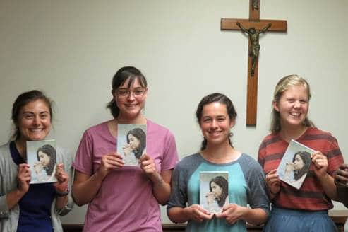 Young women posing with copies of Discerning Religious Life book.