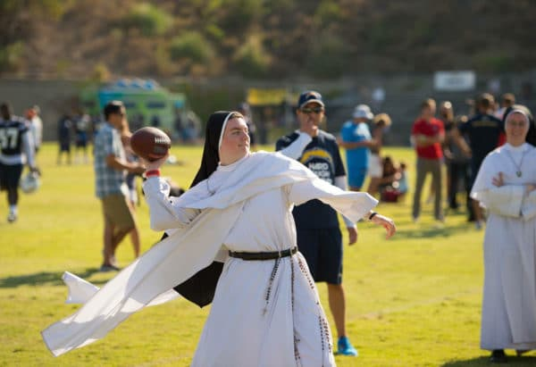 nun playing football.