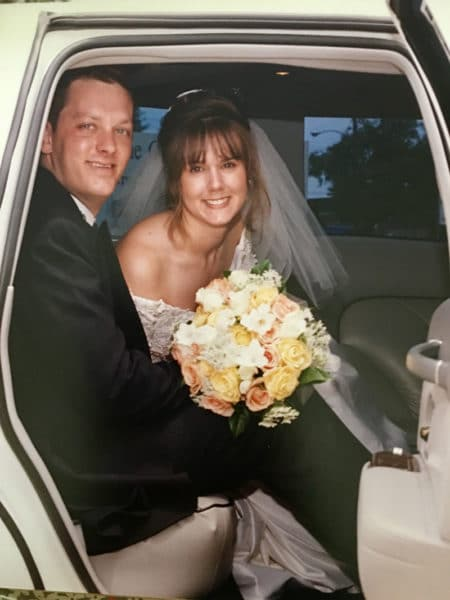 couple in a car on their wedding day