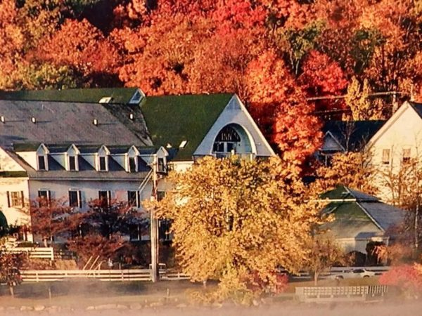 Resort in Manchester, New Hampshire with fall leaves in the background.
