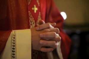 Priest praying hands.